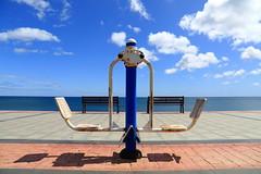 balancing the benches (Rasande Tyskar) Tags: fuerteventura canaryislands canarias islascanarias kanarischeinseln kanaren promenade walk sea meer himmel sky clouds wolken blau blue geometry gemometrisch geometric abstract beach strand