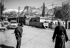 Street life in Ladakh (rvjak) Tags: inde ladakh india asia asie film pellicule argentique f3 nikon street rue men hommes old car vieille voiture mountain himalaya montagne dog chien