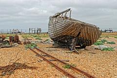 Desolation (Geoff Henson) Tags: desolation decay rust debris beach boat rails hut houses gravel sky