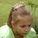 Great-niece looking through nandina