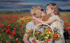 The kiss (Red Gecko Photography) Tags: wildflowers basket poppies pose kissing mother daughter andalucia spain