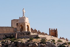 San Cristóbal statue and Alcazaba, Alermia, Spain (mattk1979) Tags: almeria sun outdoors city buildings spain europe old historic arab moorish alcazaba fortress sancristóbal statue sky clouds