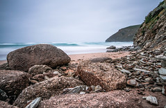 Breaking (NikNak Allen) Tags: cornwall mawganporth coast bay beach rocks rock sand stone stones sea water ocean cliff cliffs headland sky low early morning surf wave waves smooth landscape seascape longexposure