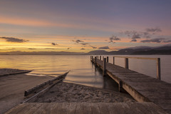 A better day (zebedee1971) Tags: landscape lake water volcano crater fishing fish trout boating sunrise clouds sun light taupo new zealand north island wharf pier wood wooden structure ramp pumice sand shore hills geothermal