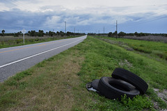 Tires Without Cars; A Road Without Cars (Comiccreator24) Tags: 1855mm nikonography nikon nikonphotographer nikond3400 nikondslr nikond3400photographer dslr d3400 digitalphotography d3400photographer digital photography vanishingpoint youngphotographer may2018 florida floridaphotographer comiccreator24 2018 seminolecountyfl seminolecounty seminole county seminolecountyflorida centralflorida centralfloridaphotographer overcast overcastskies overcastweather grayskies cloudyweather cloudysky road flickr flickrphotographer tires thelongroadahead forgotten lost isolation desolation