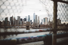 (Jonathen Adkins) Tags: city cityscape nyc manhattan buildings bridge dumbo river water skyline freedom tower helicopter brooklyn