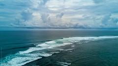 Nusa Dua Shore (0003) (Stefan Beckhusen) Tags: aerial droneshot sea shore seashore ocean openwater horizon sky clouds bali nusadua indonesia travel tourism vacation water blue color sunny day outdoor relaxation recreation