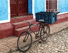 Parking (Jean S..) Tags: bicycle parking sidewalk street door window luggage stone old ancient outdoors blue red