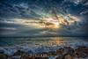 Break Through (DonMiller_ToGo) Tags: beachlife rock cloudporn sunsetmadness sunsets nature goldenhour seascapes caspersenbeach clouds waves sky sunsetsniper florida d810 beachphotography outdoors