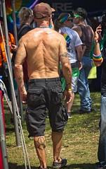 Leg Tattoos (LarryJay99 ) Tags: pridefest2018 2018 lakeworth florida festival men male man guy guys dude dudes manly virile studly stud masculine sexyman manlybutts shirtless back butts tattoos tatts nape caps headgear shoulders walking people