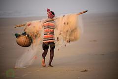 A fisherman (Joy lens) Tags: fishing fisherman sea beach morning india life sand lonely
