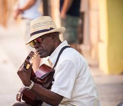 Cuba - Habana Vieja (Cyrielle Beaubois) Tags: 2016 cuba cyriellebeaubois décembre travel explore wanderlust wander portrait cuban cubano music musician hat streetphotography street people man lahabana lahavana lahavane habanavieja december canonef70200mmf40lusm bokeh guitar dof travelphotography discover