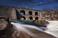 down an emerald river (cherryspicks (off)) Tags: tounj croatia bridge river longexposure tounjcica water architecture engineering