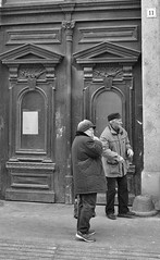 It Was Somewhere Around Here Boris (tcees) Tags: mérlegst budapest hungary pest people man woman streetphotography street door sign number urban x100 fujifilm finepix bw mono monochrome blackandwhite sidewalk pavement hat cap building