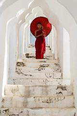 Novice Monk (Kathy~) Tags: mingun myanmar red monk novicemonks burma arch umbrella 15challengeswinner