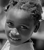Smiling Haiti Cherie (gerard eder) Tags: world travel reise viajes america centralamerica haiti portauprince people peopleoftheworld children childrenoftheworld child outdoor portrait blackandwhite blackwhite blancoynegro bw sw monochrome städte stadtlandschaft street streetlife streetart