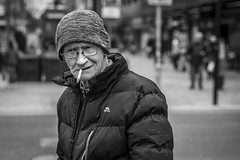 Habit (Leanne Boulton) Tags: people portrait urban street candid portraiture streetphotography candidstreetphotography candidportrait streetportrait streetlife old elderly man male face eyes expression smoke smoker smoking cigarette beanie hat cold winter tone texture detail depthoffield bokeh naturallight outdoor light shade city scene human life living humanity society culture lifestyle canon canon5d 5dmkiii 70mm ef2470mmf28liiusm black white blackwhite bw mono blackandwhite monochrome glasgow scotland uk