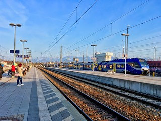 Train station of Rosenheim, Bavaria, with a waiting Meridian train