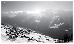 Goodbye winter (VandenBerge Photography (Back again!)) Tags: valais switzerland mountains alps riederalp blackandwhite mono light sun winter season landscape snow snowscape village aletscharena europe nature nationalgeographic pov canon sky clouds