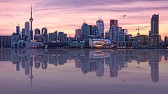 Toronto skyline (fool's itch) Tags: skyline toronto reflections architecture buildings highrises lights cranes urban sunset mirroreffect panorama bigcity hogtown cntower nikon