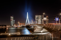 Glowing Erasmus Bridge III (Alec Lux) Tags: rotterdam architecture atmosphere bridge building canal city cityscape erasmus holland longexposure netherlands nighscape nighshot night nightscape skyline skyscraper structure urban water zuidholland nl