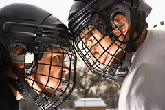 Stock Images (perfectionistreviews) Tags: colour color photograph image horizontal outdoors male boys boy twopeople 1012years 1315years teenage preteen caucasian playing ice play game winter wintersport sports sport hockey players player uniform lifestyle recreation leisure rink young youth activity multiethnic faceoff intimidation intimidate profile headandshoulder cage helmet mask competition compete challenge icehockey practice sportsandrecreation