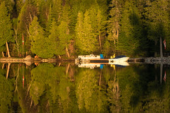 'Flags, Boats, Trees, Rocks and Shadow' (Canadapt) Tags: shoreline reflection boat flags sunrise morning shadow keefer canadapt