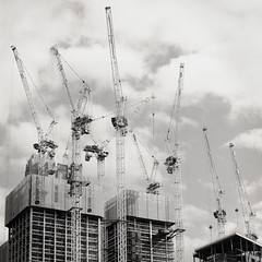 Cranes 1 (CactusD) Tags: london architecture construction cranes southbank south bank city skyline england nikon d800e fx uk unitedkingdom gb greatbritain great britain united kingdom mamiya rz67 film 120 60mmf28afsmicro 60mm afs f28 micro macro digitized 110mmf28 110mm 6x7 monochrome blackandwhite black white bw ilfordfilm ilford delta400