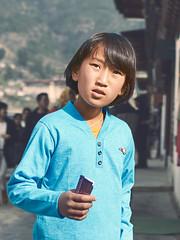 Bhutan: Paro Street Portrait I. (icarium.imagery) Tags: bhutan drukyul himalayas sonydscrx1r travel captureone child naturallight portrait street streetportrait paro expression sundaylights