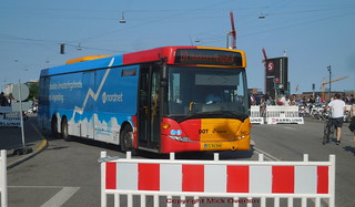 Distortion street party blockade allows 1A Scania Omnilink 1147 to pass