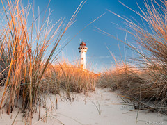 Lighthouse (✦ Erdinc Ulas Photography ✦) Tags: lighthouse vuurtoren nederland netherlands dutch holland dunes duinen sand focus landmark aan zee egmond strand beach panasonic sky blue clouds travel jcj van speijk tower glass view low angle shot shadow light sun old town