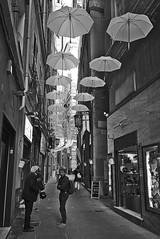 White umbrellas (Blizzard 70) Tags: 2018 genova street bianconero outdoor centrostorico