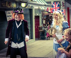 Alice in Norwich Market (denise.ferley) Tags: peopleinthestreet peoplewatching streetphotography candidphotography iphone oneaday fun halftermfun madhatter aliceinwonderland norwichmarket citylife urban uk thisisnorwich thisisengland