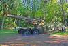Howitzer, Errerson Park, Williston, Florida (2 of 2) (gg1electrice60) Tags: cannon onwheels memorialized plaque gun artillery 8wheels eightwheels ondisplay howitzer 8inchm2cannon cityofwilliston williston levycounty florida fl unitedstates usa us america eppersonpark 530enobleavenue 530eastnobleave usroute27 route27 betweense5thstse6thst acrossfrombabcockfurniture obtainedfromannisonalabamaarmydepot obtainedbywillistononapril301975 downtownwilliston downtown park grass trees shrubs bench flattires sign description rustycrusty rustyandcrusty