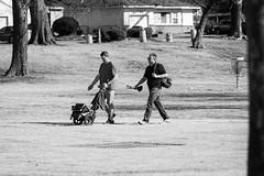 on to the next hole (fallsroad) Tags: tulsaoklahoma riversidepark frisbee golf people street public candid game play blackandwhite bw monochrome men