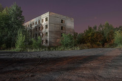 The lovely light at the end of the road (Markus Lehr) Tags: ruin concrete derelict building trees shadows notsoemptyforeground tyremarks night darkness nightphotography longexposure nopeople peoplelessness humantraces manmadelandscape urbanspace katowice poland markuslehr