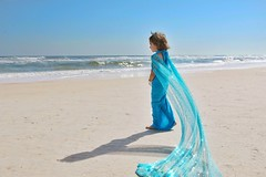 She does not claim the ocean is hers, but she sure looks like she does! (PointOfUPhotography) Tags: pointofuphotography flowingcape cape sky oceanscene sand bluedress littleprincess blue ocean princess