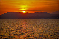 the charm of sunset (kurtwolf303) Tags: sunset sundown orange sky sonne sun sol meer mittelmeer ocean seascape segelboot boat canoneos600d digitalphotography gegenlicht backlight silhouette water mare mediterraneansea sailboat sailingboat landscape