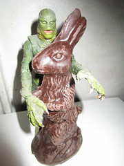 Easter Creature and Chocolate Rabbit 9081 (Brechtbug) Tags: easter creature chocolate bunny rabbit 2018 universal pictures studio black lagoon monsters new york city undead zombie cadaver horror terror halloween fright toy toys moody shadow shadows face portrait 1954 movie film hollywood fish man gill gillman collectable collectible type lite light holiday gloomy goth gothic action figure chocolates eeeaster april fools green 04012018