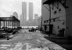 11 years after taking my favorite World Trade Center photo, the scene had changed a bit. The old Colgate Plant was being demolished. Across the Hudson, the new Battery Park City partially obscured the Twin Towers. Jersey City.  March 1986. (wavz13) Tags: oldphotographs oldphotos 1980sphotographs 1980sphotos oldphotography 1980sphotography vintagephotographs vintagephotos vintagephotography filmphotos filmphotography historicphotographs historicphotos historicphotography newyorkphotographs newyorkphotos oldnewyorkphotography oldnewyorkphotos vintagenewyork vintagemanhattan oldworldtradecenter vintageworldtradecenter twintowers originalworldtradecenter secretplaces hiddenplaces forgottenplaces bleak noir noire jerseycityphotographs jerseycityphotos oldjerseycityphotography oldjerseycityphotos oldjerseycity vintagejerseycity vintagejerseycityphotography jerseycityhistory urbanphotography urbanphotos urbanscenes cityphotography cityphotos vintage35mm old35mm industrialjerseycity industrialruins factoryruins industrialwasteland abandonedrails abandonedrailroads abandonedtracks urbandecay urbanwasteland urbanblight urban urbanexploration manhattanskyline newyorkskyline newyorkskyscapers manhattanskyscapers industry industrial oldindustrial vintagefactory oldfactory vintagefactories oldfactories manhattanhistory newyorkhistory hudsonriver