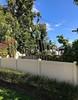 Over two Fences (LarryJay99 ) Tags: wawafence fence foliage flowers happyfencefriday debris junk lake worth beach worthfloridaparking lotblue sky vegetation vines