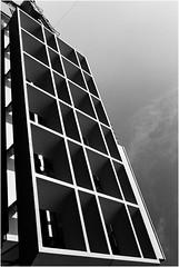 Open Shield (Thomas Listl) Tags: thomaslistl blackandwhite noiretblanc biancoenegro contrasts filmphotography analog minolta minoltax700 35mm kodak tmax tmax400 push push1stop architecture graphical geometry geometric lines sky