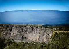 Kīlauea and Mauna Loa (wyojones) Tags: hawaii hawaiivolcanoesnationalpark kīlaueassummitcrater cliffs kīlauea maunaloa crater wall active trees wyojones np