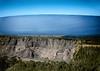 Kīlauea and Mauna Loa (wyojones) Tags: hawaii hawaiivolcanoesnationalpark kīlaueassummitcrater cliffs kīlauea maunaloa crater wall active trees