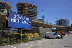 Low Cost High Impact (Clayton Perry Photoworks) Tags: vancouver bc canada explorebc explorecanada spring yaletown sign billboard