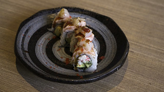 Kaka Special Roll - salmon, kani, cucumber, uni sauce, rolled in tobiko, kaka sauce