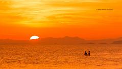 Sunset Swim (Jo Bet) Tags: sunset beach ocean skies swim pair minimalist sun water iloilo philippines iamiloilo ilonggo oton orange clouds