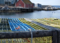 Lobster traps (halifaxlight) Tags: canada novascotia peggyscove lobstertraps fishingvillage traps sheds sea docks bokeh yellow red blue