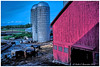 Farm therapy. (Fotofricassee) Tags: barn red cow brown silo clouds mud