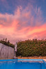Quick Dip Before The Storm? (Claude Downunder) Tags: storm clouds cloud pool water bush bushes fence swimmingpool sunset sky